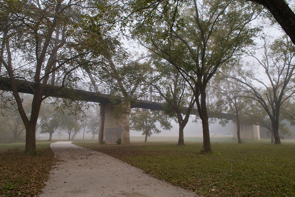 foggy landscape with bridge by rusty ray