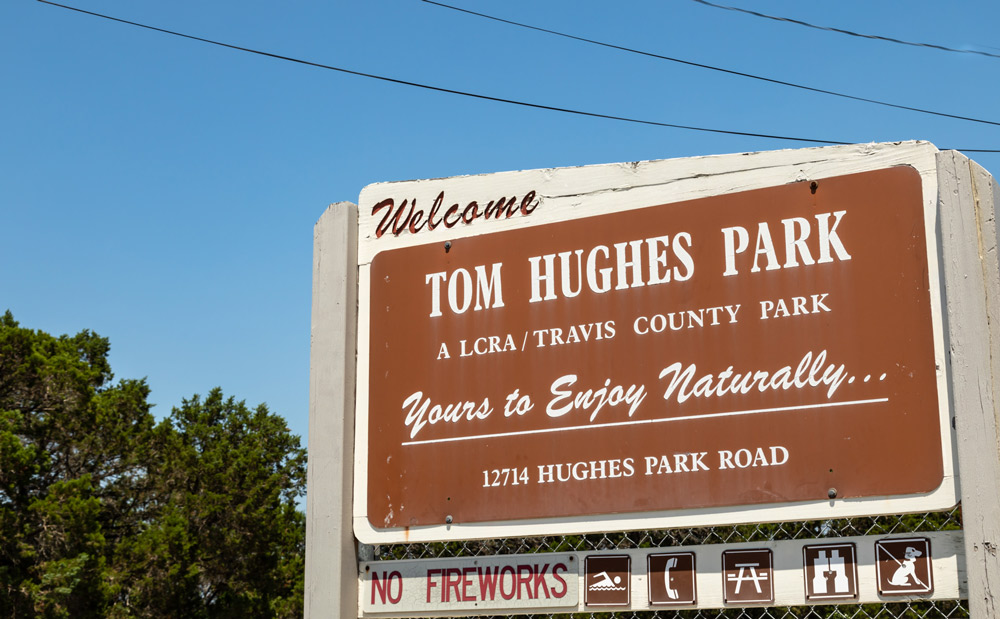 tom hughes park's welcome sign by tom hausler